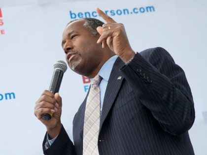 Republican presidential candidate Ben Carson speaks outside the Alpha Gamma Rho house during a campaign stop at Iowa State University on October 24, 2015 in Ames, Iowa. A recent poll indicates that Carson has surged past Donald Trump to lead the race for the Republican presidential nomination in Iowa. (Photo …
