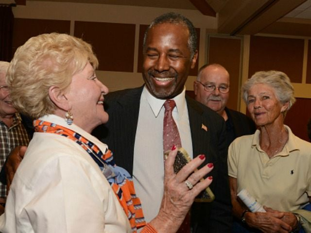 Republican presidential candidate Ben Carson speaks with supporters following a town hall event at River Woods September 30, 2015 in Exeter, New Hampshire. Carson has risen in the most recent polls to pull almost even with front runner Donald Trump. (Photo by