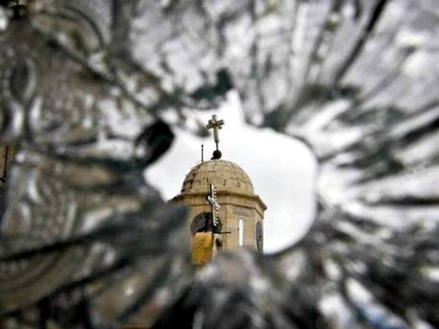 Church seen through bullet hole in glass Muzaffar SalmanAssociated Press