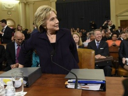 Former Secretary of State and Democratic Presidential hopeful Hillary Clinton arrives to testify before the House Select Committee on Benghazi on Capitol Hill in Washington, DC, October 22, 2015. AFP PHOTO / SAUL LOEB (Photo credit should read