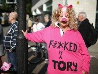 MANCHESTER, ENGLAND - OCTOBER 04: People take part in an anti-austerity protest during the first day of the Conservative Party Autumn Conference 2015 on October 4, 2015 in Manchester, England.