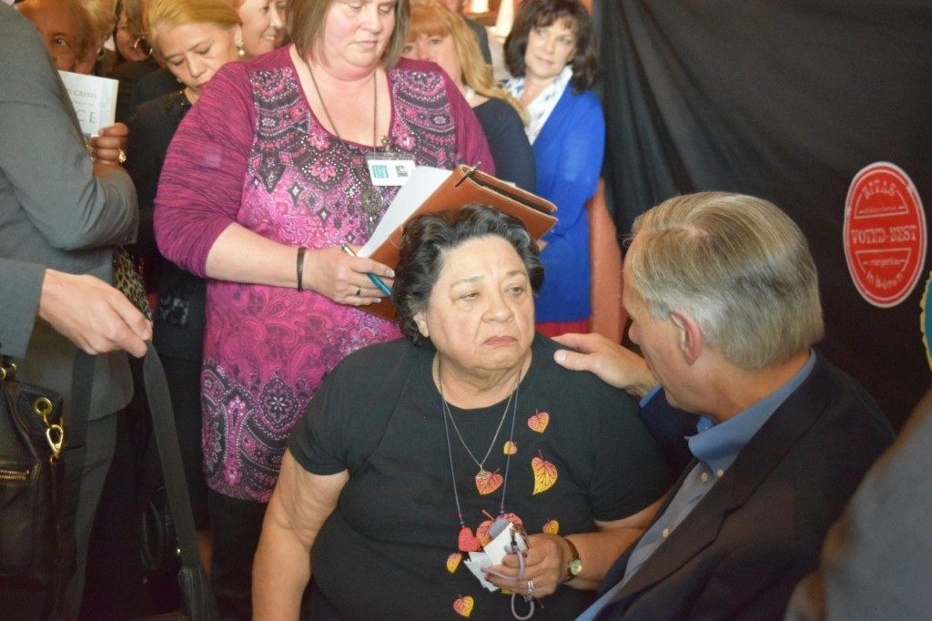 Governor Abbott speaking with a Houston woman following the grass roots rally. (Breitbart Texas Photo/Bob Price)