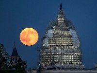 In this handout provided by the National Aeronautics and Space Administration (NASA), a second full moon for the month of July rises behind the dome of the U.S. Capitol on July 31, 2015 in Washington, DC. In recent years, people have been using the name Blue Moon for the second …
