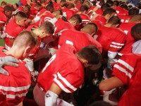 Football prayer (Joe Raedle / Hulton Archive / Getty)