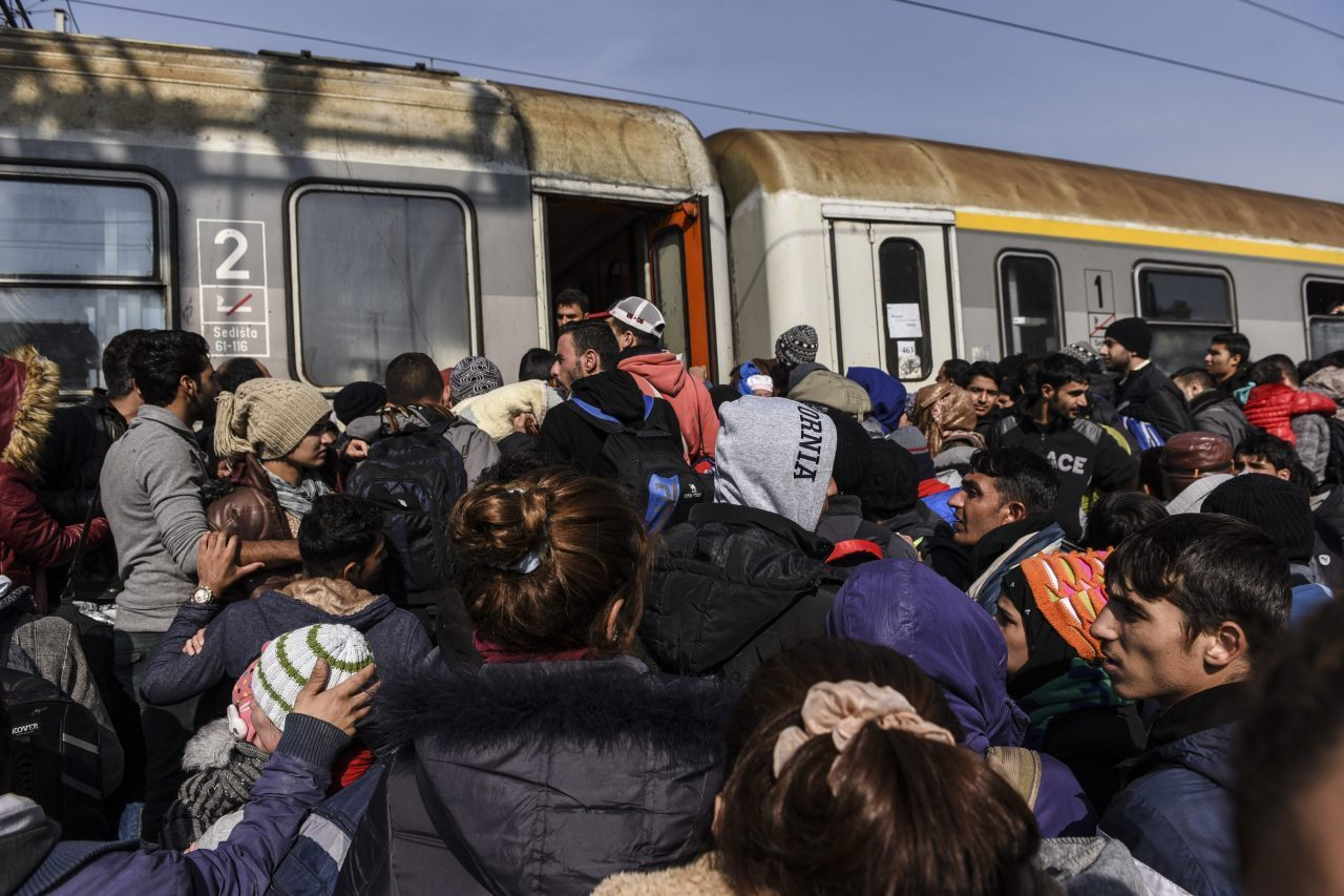 Migrants and asylum seekers board a train heading to Croatia after crossing the Macedonian-Serbian border near the town of Bujanovac on October 26, 2015. The EU pledged to help set up 100,000 places in reception centres along the migrant route through the Balkans, in a bid to end rising tensions on its eastern frontier over how to deal with the crisis. AFP PHOTO / ARMEND NIMANI (Photo credit should read ARMEND NIMANI/AFP/Getty Images)