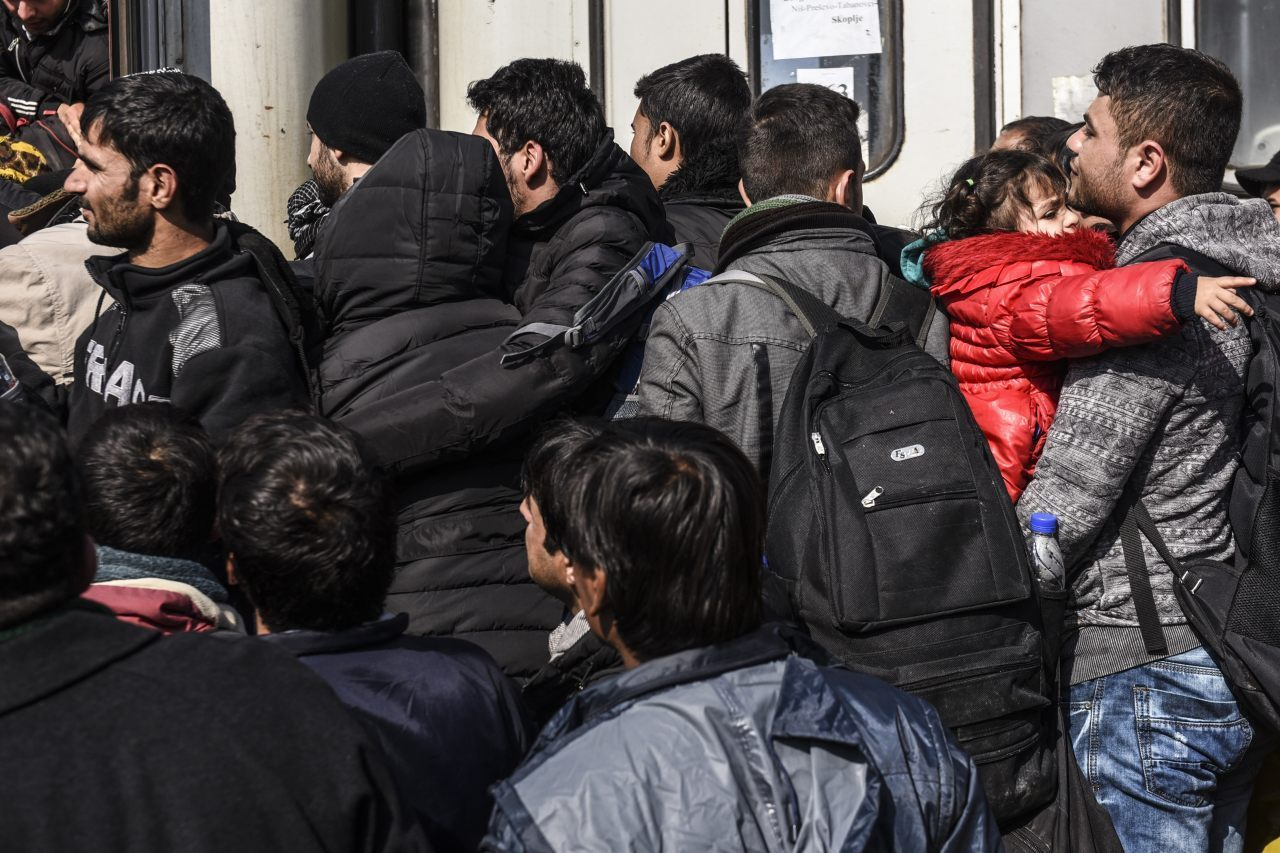 Migrants and asylum seekers queue to board a train heading to Croatia after crossing the Macedonian-Serbian border near the town of Bujanovac on October 26, 2015. The EU pledged to help set up 100,000 places in reception centres along the migrant route through the Balkans, in a bid to end rising tensions on its eastern frontier over how to deal with the crisis. AFP PHOTO / ARMEND NIMANI (Photo credit should read ARMEND NIMANI/AFP/Getty Images)