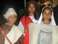 three Belizean children from San Pedro Town dressed as Christian saints, martyrs and Biblical figures for the observance of Allhallowtide. It is common for Christian schools to host parties on the first two days of this triduum, All Hallows' Eve (Halloween) and All Hallows' Day (All Saints' Day), in which …