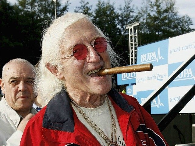 NEWCASTLE, ENGLAND - OCTOBER 1: Sir Jimmy Saville prepares for The Bupa Great North Run on October 1, 2006 in Newcastle, England.
