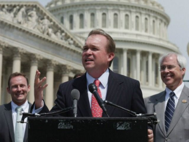 Rep. Mick Mulvaney (R-SC) (C) speaks during a news conference with a bipartisan group of House members, including Rep. Patrick Murphy (D-FL) (L) and Rep. John Barrow (R-GA), outside the U.S. Capitol May 20, 2014 in Washington, DC. Murphy and Mulvaney are co-sponsoring legislation 'aimed at modernizing America's regulatory system …