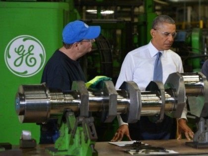 President Barack Obama tours the General Electric Waukesha Gas Engines facility on January 30, 2014 in Waukesha, Wisconsin. The President is expected to discuss taking executive action to enhance reform of job training programs. GE's Waukesha gas engines plant, is a facility that employs around 700 people and manufactures natural …