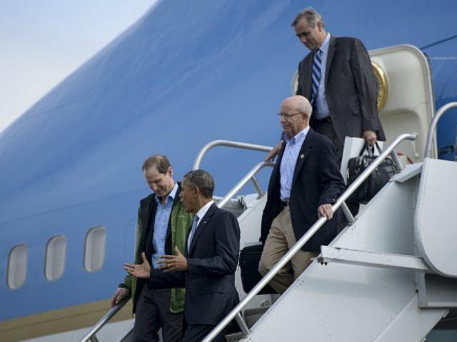 President Barack Obama (R) arrives with Senator Ron Wyden (D-OR) (L), Rep. Peter DeFazio (D-OR) and Senator Jeff Merkley (D-OR) at Eugene Airport October 9, 2015 in Eugene, Oregon. Obama is traveling to Oregon to visit with shooting victims' loved ones before traveling to California to fund raise for Democrats. …