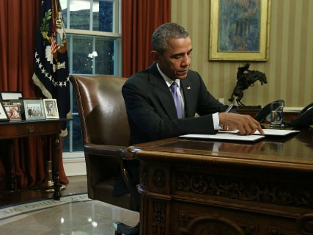 U.S. President Barack Obama signs a veto of H.R. 1735 National Defense Authorization Act (NDAA) in the Oval Office October 22, 2015 in Washington, DC. President Obama and Congressional Democrats object to the measure because it uses some $90 billion meant for war spending to avoid automatic budget cuts to military programs. (Photo by