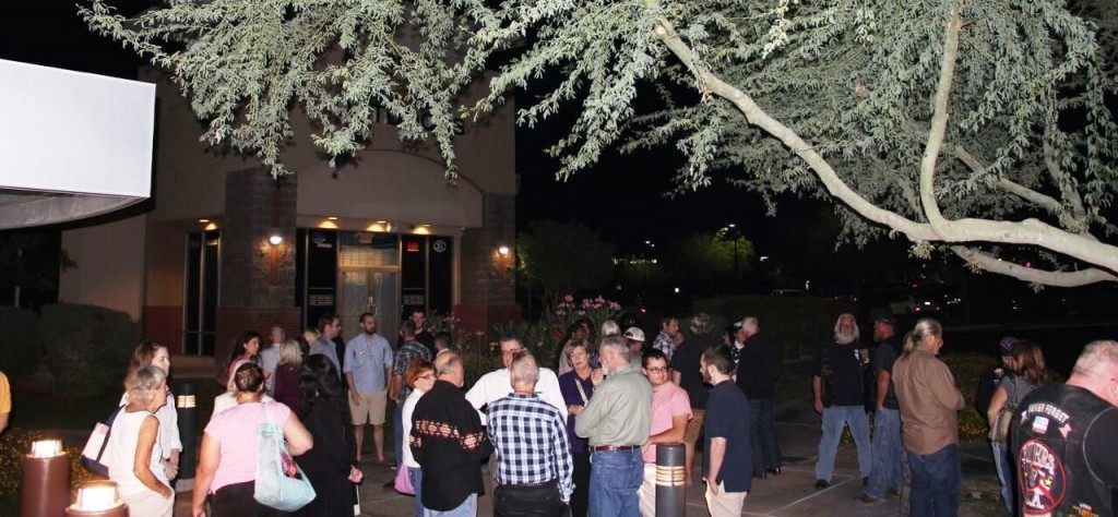 "After following police orders to ""disperse"" attendees gather at safer confines -- the Scottsdale Gun Club. (Photo: Breitbart News)"
