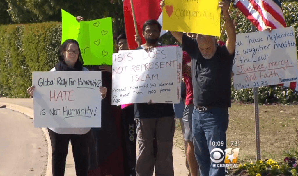 Pro-Islam supporters stand outside a Texas mosque in Richardson. (Photo: CBSDFW 11 Video Screenshot)
