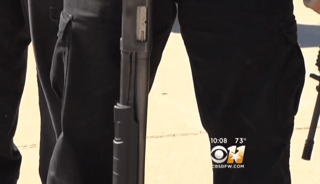 Armed protesters in Texas stand outside a Richardson mosque. (Photo: CBSDFW 11 Video Screenshot)