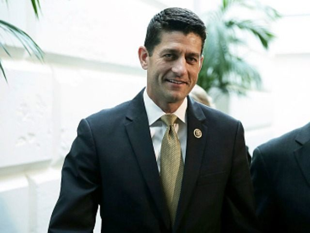 Rep. Paul Ryan (R-WI) (L) leaves with Rep. Luke Messer (R-IN) after a House Republican Conference meeting October 21, 2015 at the Capitol in Washington, DC. Rep. Ryan said he is open to running for Speaker of the House if the GOP will unify behind him.