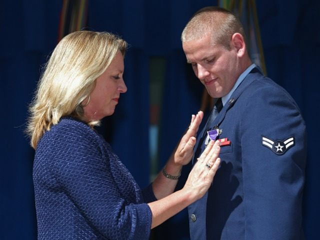 Air Force Airman 1st Class Spencer Stone (R) receives the Purple Heart medal from Secretary of the Air Force Deborah Lee James during an awards ceremony for the three men who helped stop a gunman on a Paris-bound train last month at the Pentagon September 17, 2015 in Arlington, Virginia. …