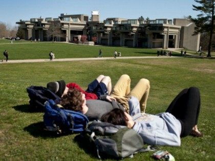 Students at the University of Massachusetts Dartmouth hang out in the quad on campus on April 26, 2013 in Dartmouth, Massachusetts.
