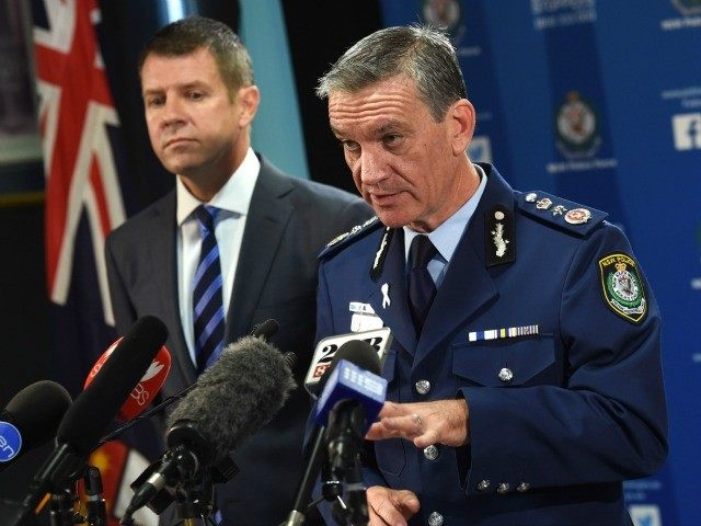 New South Wales police commissioner Andrew Scipione (R) and state Premier Mike Baird speak to the media in Sydney on October 3, 2015, the day after an attack in Sydney in which a 15-year-old gunman shot dead a civilian police employee.