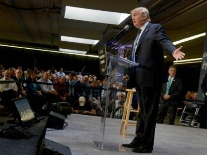 Republican Presidential candidate Donald Trump speaks at the No Labels Problem Solver convention October 12, 2015 in Manchester, New Hampshire. Eight presidential candidates addressed the bipartisan event which included many undecided New Hampshire voters. (Photo by