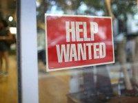 A help wanted sign is seen in the window of the Unika store on September 4, 2015 in Miami, Florida. The U.S. Bureau of Labor Statistics released the August jobs report that shows that the economy created just 173,000 new jobs last month. But the unemployment rate dipped to 5.1%, …