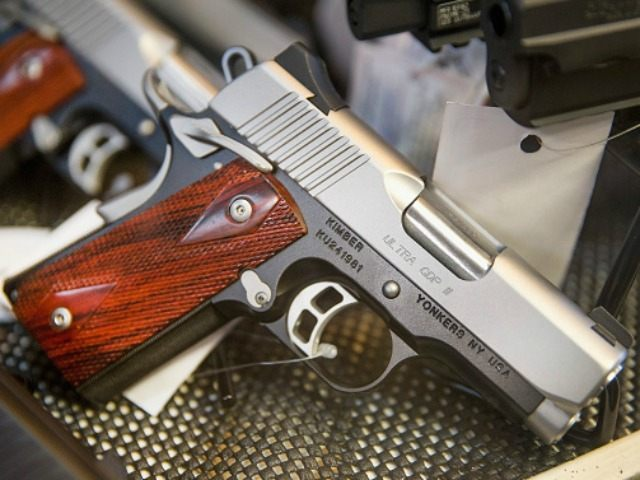 Handguns are offered for sale at Freddie Bear Sports on March 11, 2015 in Tinley Park, Illinois. According to a survey conducted by the University of Chicago 32 percent of Americans own guns, down from a high of 50 percent of the population in the 1970s and early 1980s.