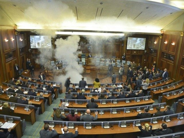 tear-gas-at-kosovo-parliament-during-talks-on-serbian-relations-AP