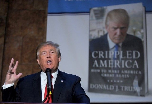 """Donald Trump at a signing for his book, """"Crippled America""""."""