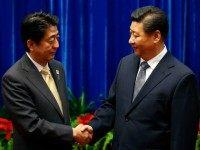 BEIJING, CHINA - NOVEMBER 10: China's President Xi Jinping (R) shakes hands with Japan's Prime Minister Shinzo Abe, during their meeting at the Great Hall of the People, on the sidelines of the Asia Pacific Economic Cooperation (APEC) meetings, November 10, 2014 in Beijing, China. APEC Economic Leaders' Meetings and …