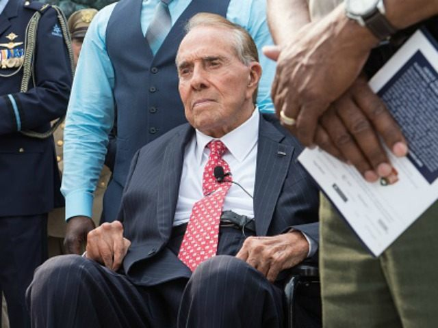 Former US Senator and presidential candidate Bob Dole attends a ceremony marking the 70th anniversary of the Allied Forces victory over Japan in the Pacific at the World War II Memorial in Washington, DC, on September 2, 2015. AFP PHOTO/NICHOLAS KAMM (Photo credit should read