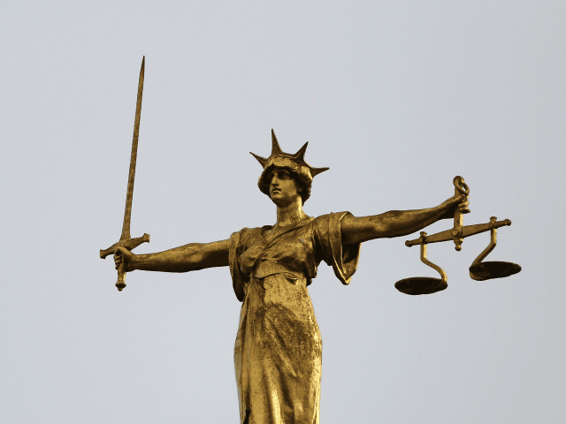 LONDON, ENGLAND - FEBRUARY 16: A statue of the scales of justice stands above the Old Bailey on February 16, 2015 in London, England.