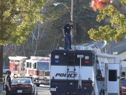 Burning SUV story (Jeff Gretchen / The Register / Associated Press)