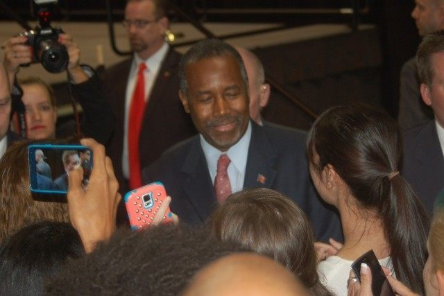 Ben Carson greets rally attendees following his speech