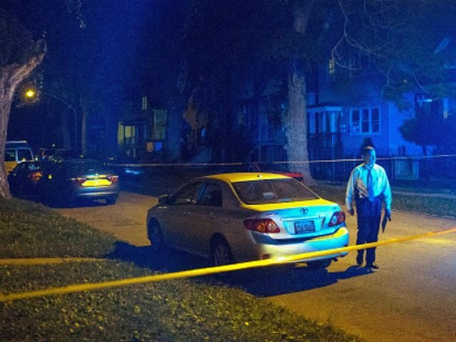Police officers investigate a shooting scene where 5 people were reported to have been shot, including an 11-month-old infant, on September 28, 2015 in Chicago, Illinois. Chicago, like many major cities in the United States, has experienced a surge in shootings this year. (Photo by
