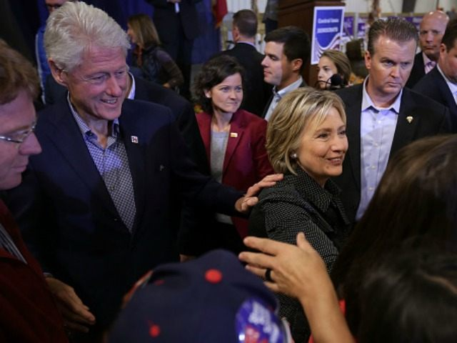Democratic presidential candidate Hillary Clinton and her husband and former President Bill Clinton greet Iowans during the Central Iowa Democrats fall barbecue November 15, 2015 at Hansen Agriculture Student Learning Center of Iowa State University in Ames, Iowa. Clinton continued to campaign for the nomination from the Democratic Party. (Photo …