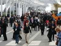 Conference attendees walk in the COP 21 United Nations conference on climate change, on November 30, 2015 in Le Bourget, on the outskirts of the French capital Paris. More than 150 world leaders are meeting under heightened security, for the 21st Session of the Conference of the Parties to the …