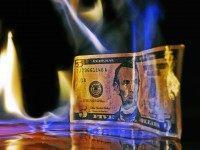 Dollar on fire (Mike Poresky / Flickr / CC / Cropped)