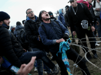 Stranded Migrants Try To Storm into Macedonia, Tear Down Fence