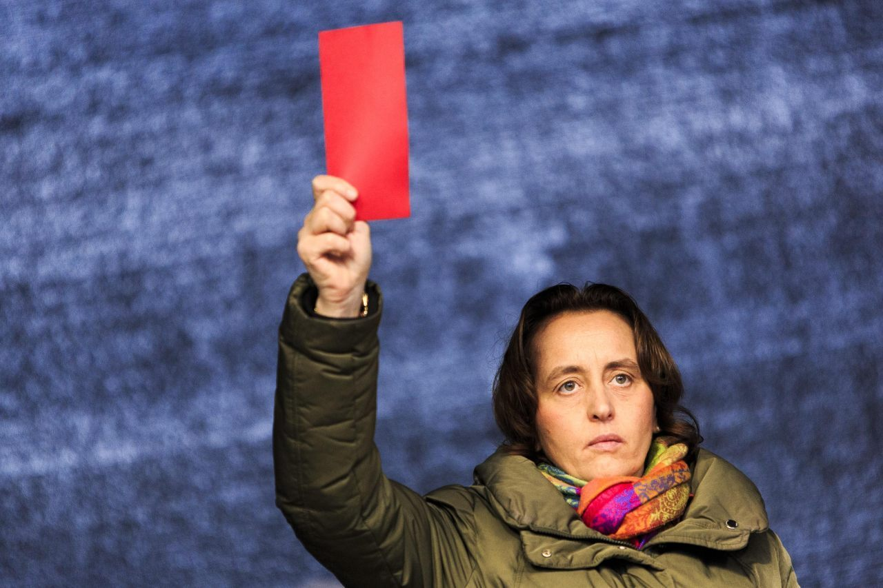 Beatrix von Storch, member of the European Parliament, gives Merkel the red card (Carsten Koall/Getty Images)