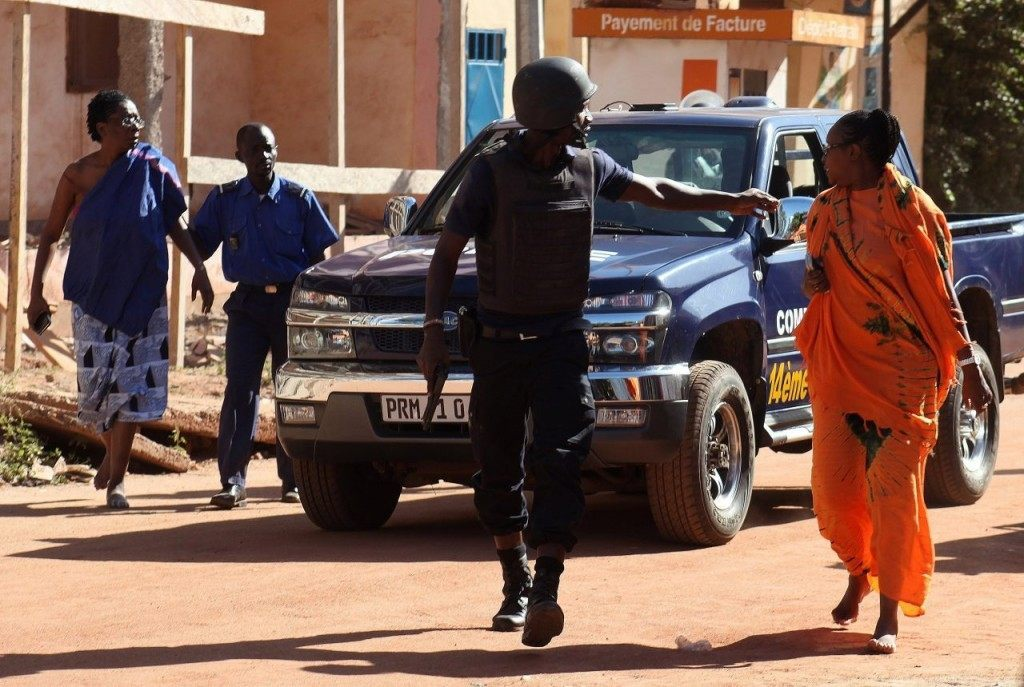 Malian security forces evacuate two women from an area surrounding the Radisson Blu hotel in Bamako on November 20, 2015.