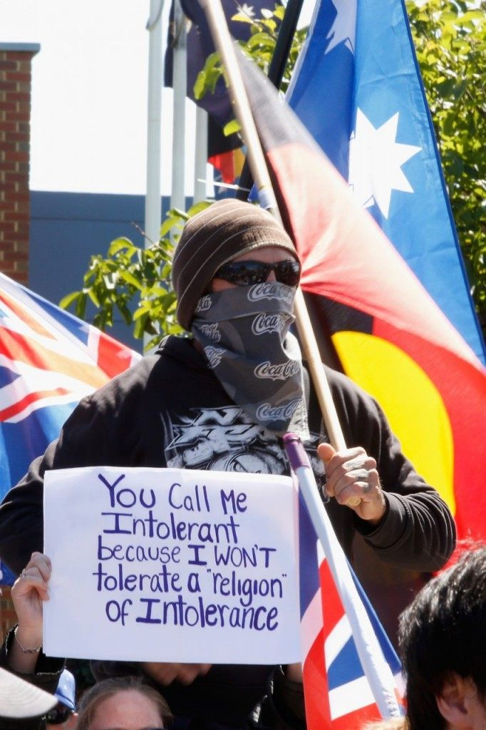 MELBOURNE, AUSTRALIA - NOVEMBER 22: A masked protester is seen during a Reclaim Australia rally held in Melton on November 22, 2015 in Melbourne, Australia. Protestors gathered near the Melton Community Hall to voice their opinions on Australia's laws and cultures.