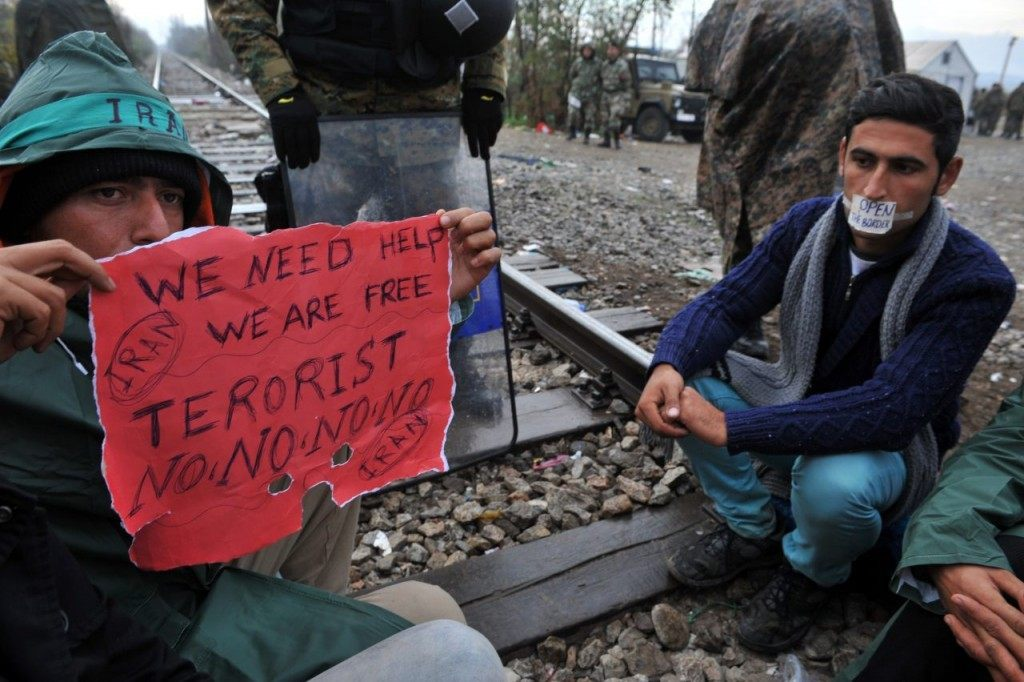 Migrants demonstrate as they wait to cross the Greek-Macedonian border near Idomeni on November 25, 2015. Since last week, Macedonia has restricted passage to northern Europe to only Syrians, Iraqis and Afghans who are considered war refugees. All other nationalities are deemed economic migrants and told to turn back. Over 1,500 people are stuck on the border, mostly Indians, Moroccans, Bangladeshis and Pakistanis. AFP PHOTO /Sakis Mitrolidis / AFP / SAKIS MITROLIDIS (Photo credit should read SAKIS MITROLIDIS/AFP/Getty Images)