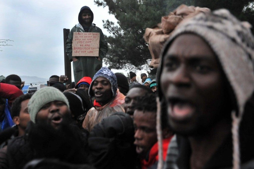 Migrants and refugees from African countries demonstrate as they wait to cross the Greek-Macedonian border near Idomeni on November 25, 2015. Since last week, Macedonia has restricted passage to northern Europe to only Syrians, Iraqis and Afghans who are considered war refugees. All other nationalities are deemed economic migrants and told to turn back. Over 1,500 people are stuck on the border, mostly Indians, Moroccans, Bangladeshis and Pakistanis. AFP PHOTO /Sakis Mitrolidis / AFP / SAKIS MITROLIDIS (Photo credit should read SAKIS MITROLIDIS/AFP/Getty Images)