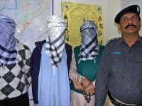 A Pakistani police officer displays memb