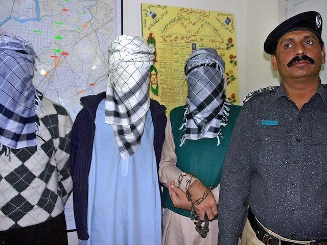 A Pakistani police officer displays memb