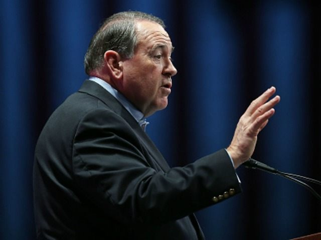 Republican presidential candidate former Arkansas Governor Mike Huckabee speaks during the Sunshine Summit conference being held at the Rosen Shingle Creek on November 13, 2015 in Orlando, Florida. The summit brought Republican presidential candidates in front of the Republican voters. (Photo by)