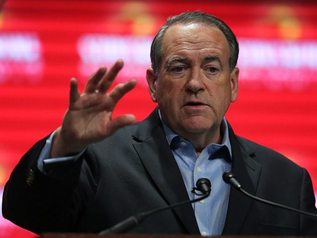 Republican presidential candidate former Arkansas Governor Mike Huckabee speaks during the Sunshine Summit conference being held at the Rosen Shingle Creek on November 13, 2015 in Orlando, Florida. The summit brought Republican presidential candidates in front of the Republican voters. (Photo by )