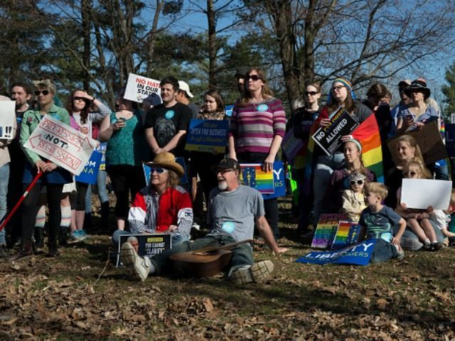 Demonstrators gather at Karst Farm Park on March 31, 2015 in Bloomington, Indiana. Responding to widespread criticism nationally over the state's new controversial Religious Freedom Restoration Act, which critics say can be used to discriminate against gays and lesbians, Indiana Gov. Mike Pence today called on the Republican-controlled general assembly …