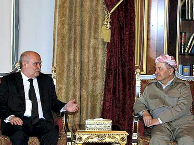 Iraqi Kurdish Regional President Massoud Barzani (R) meets with Turkish Foreign Minister Feridun Sinirlioğlu Reuters