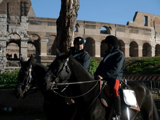 Mounted police patrol near the Arch of Constantine on November 25, 2015 in Rome. Italy is to spend an additional one billion euros ($1.06 billion) on security, Italian Prime Minister Matteo Renzi announced today. In a speech at Rome city hall, he said 500 million euros would be earmarked for …